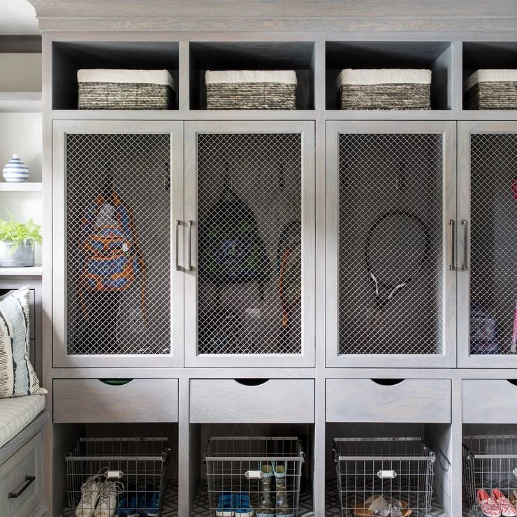 An organized mud room with lockers.
