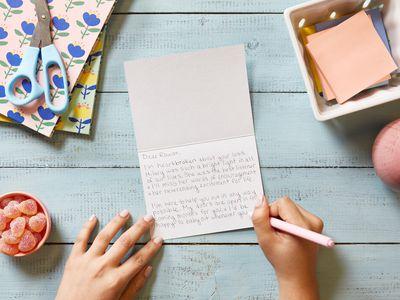 someone writing a sympathy card