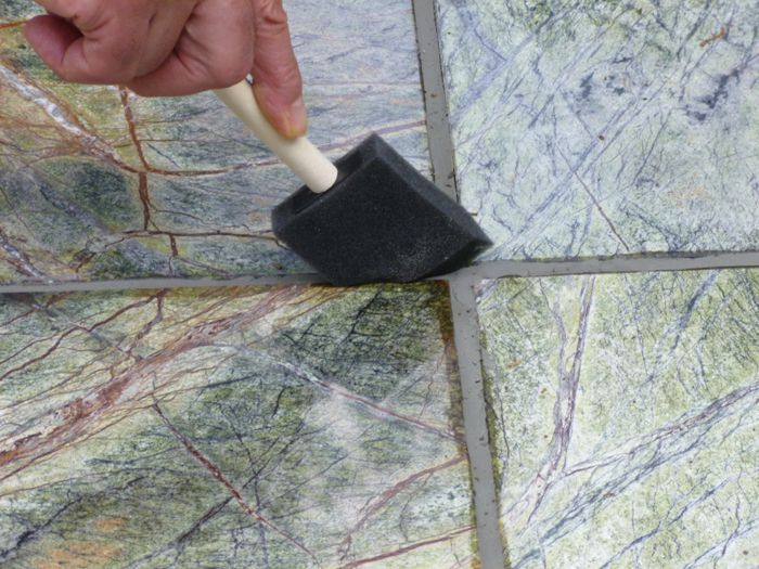 Sealing marble grout joints with a brush