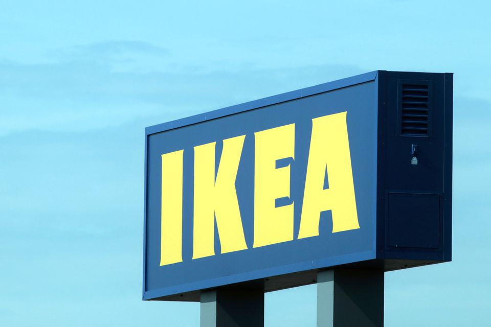 Ikea's sign towering over one of its stores full of Scandinavian-inspired designs