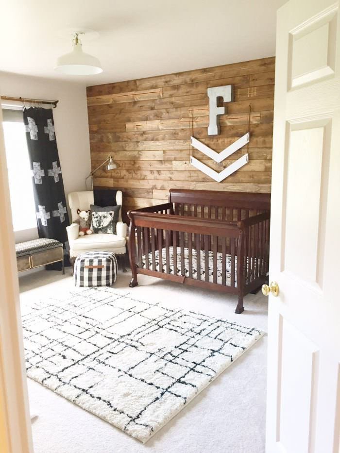 Bright, contemporary nursery with rustic wood paneled accent wall