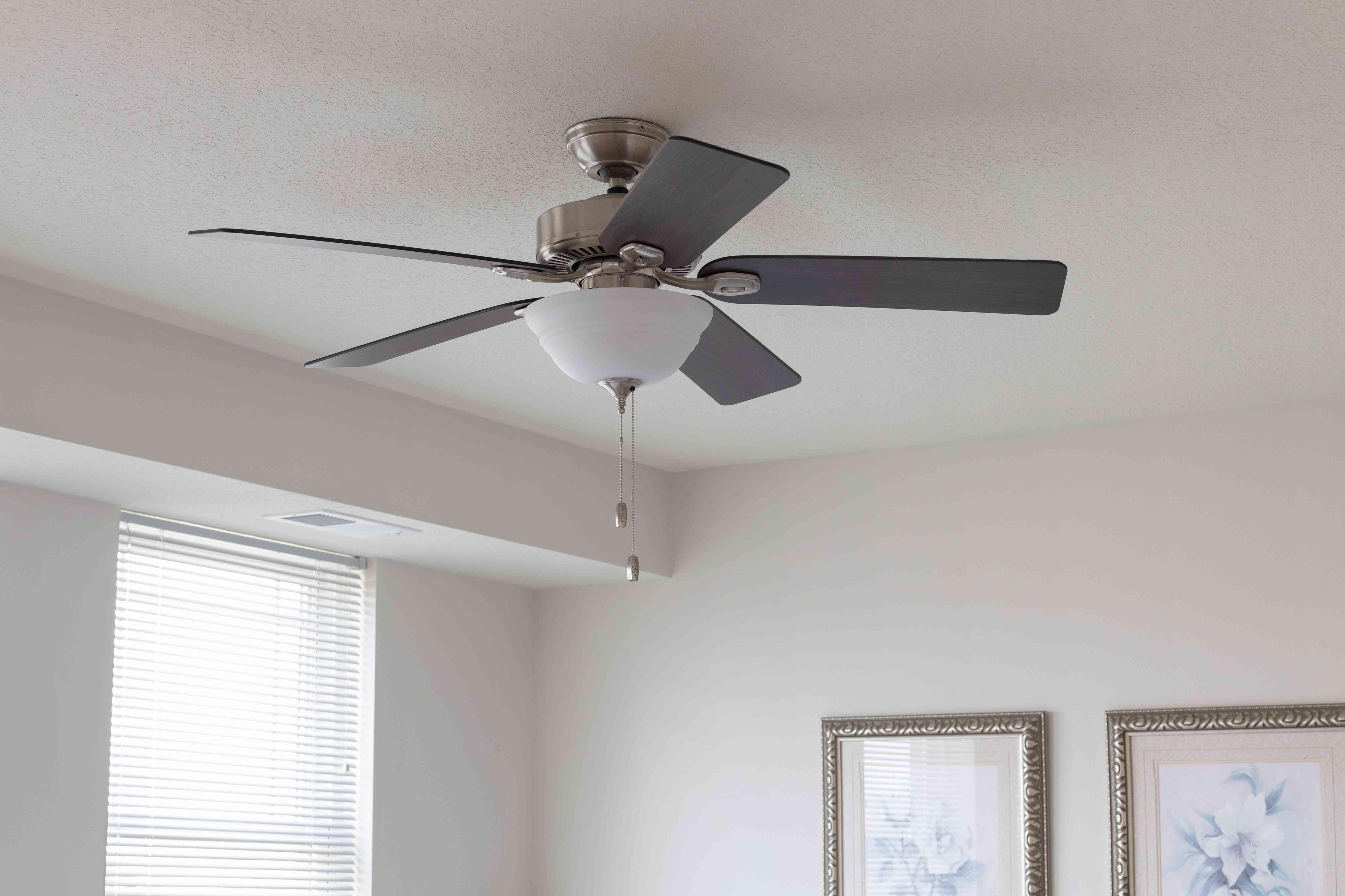 Ceiling fan in house to lower electricity bill