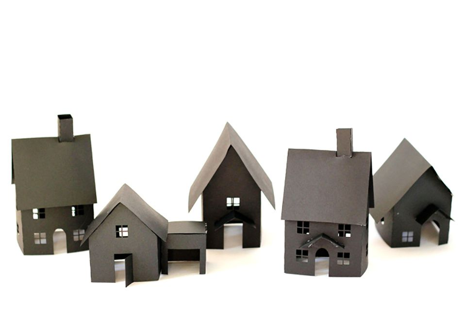 A group of gray paper houses