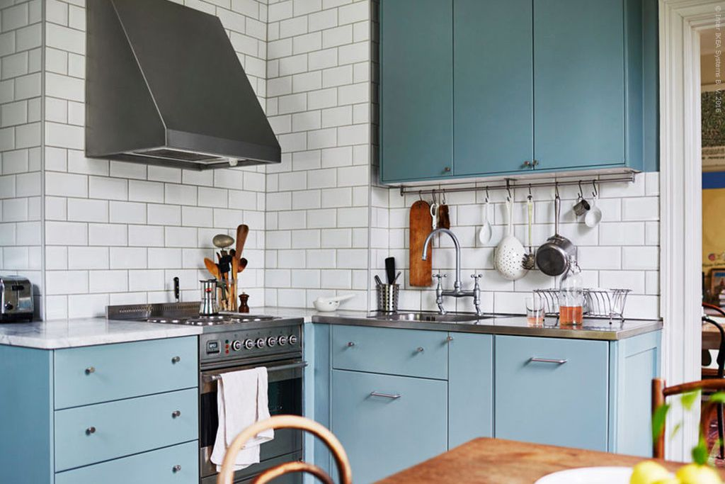 Dusty blue kitchen cabinets with subway tile