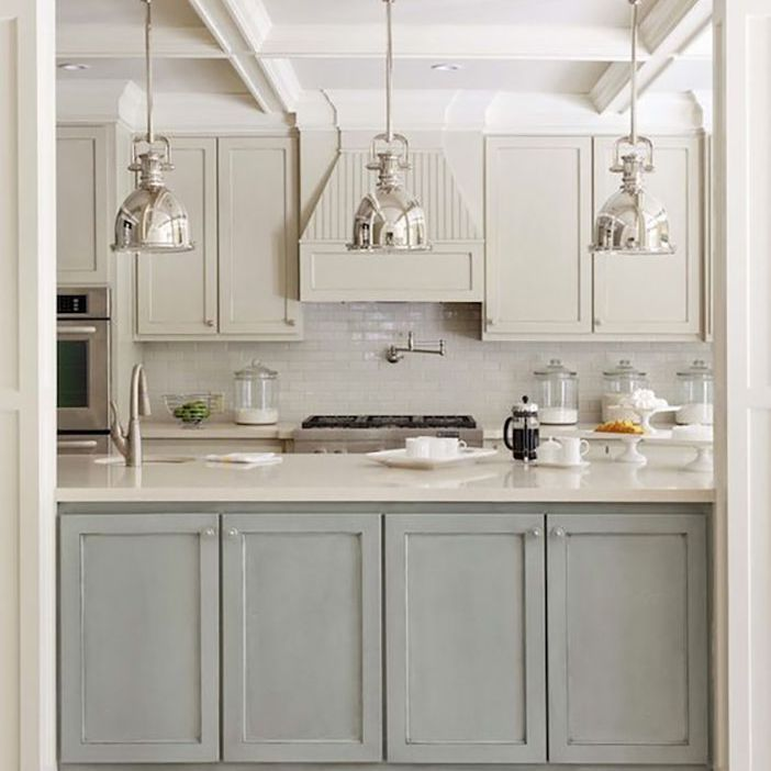Kitchen With White Cabinets And Gray Island