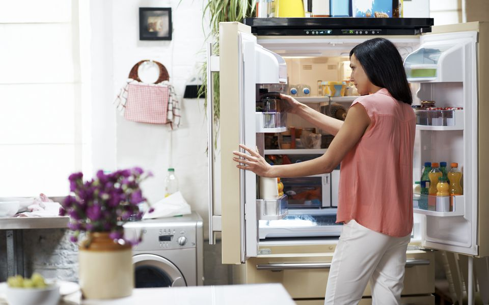 Woman looking in the fridge