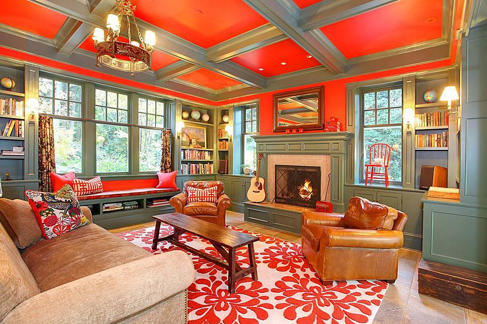 Living room decorated in warm colors with a fire in the fireplace