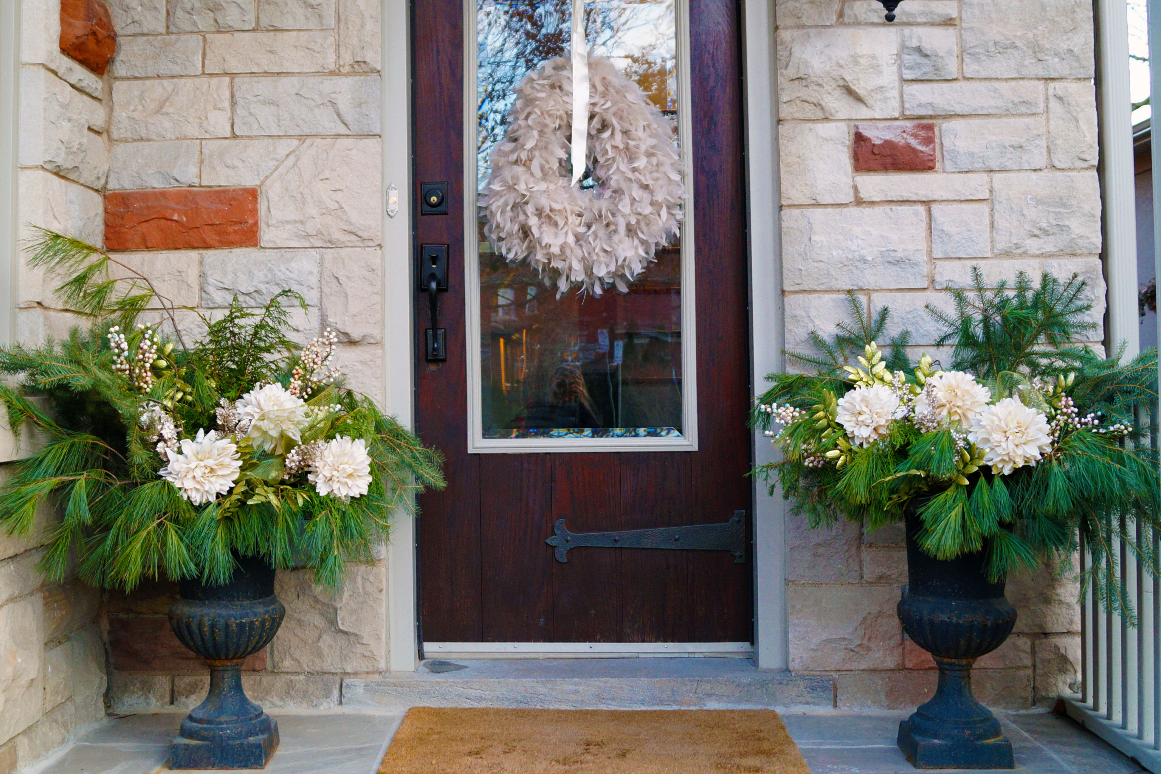 white and green winter porch planters