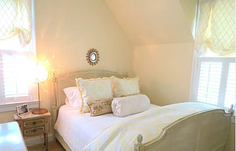 Bed in a French country bedroom