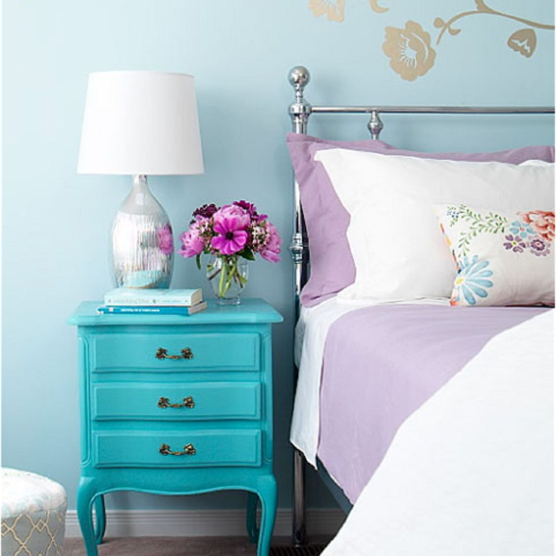 Turquoise dresser in a vintage bedroom