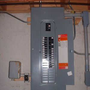 An electrical panel mounted on the wall.