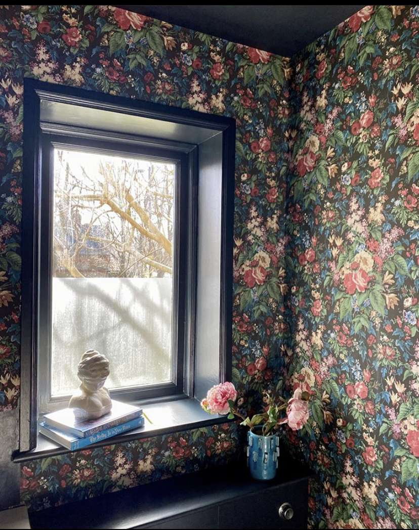 Room with floral wallpaper and a window