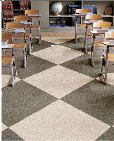Vinyl floor tiles found in a classroom with desks.