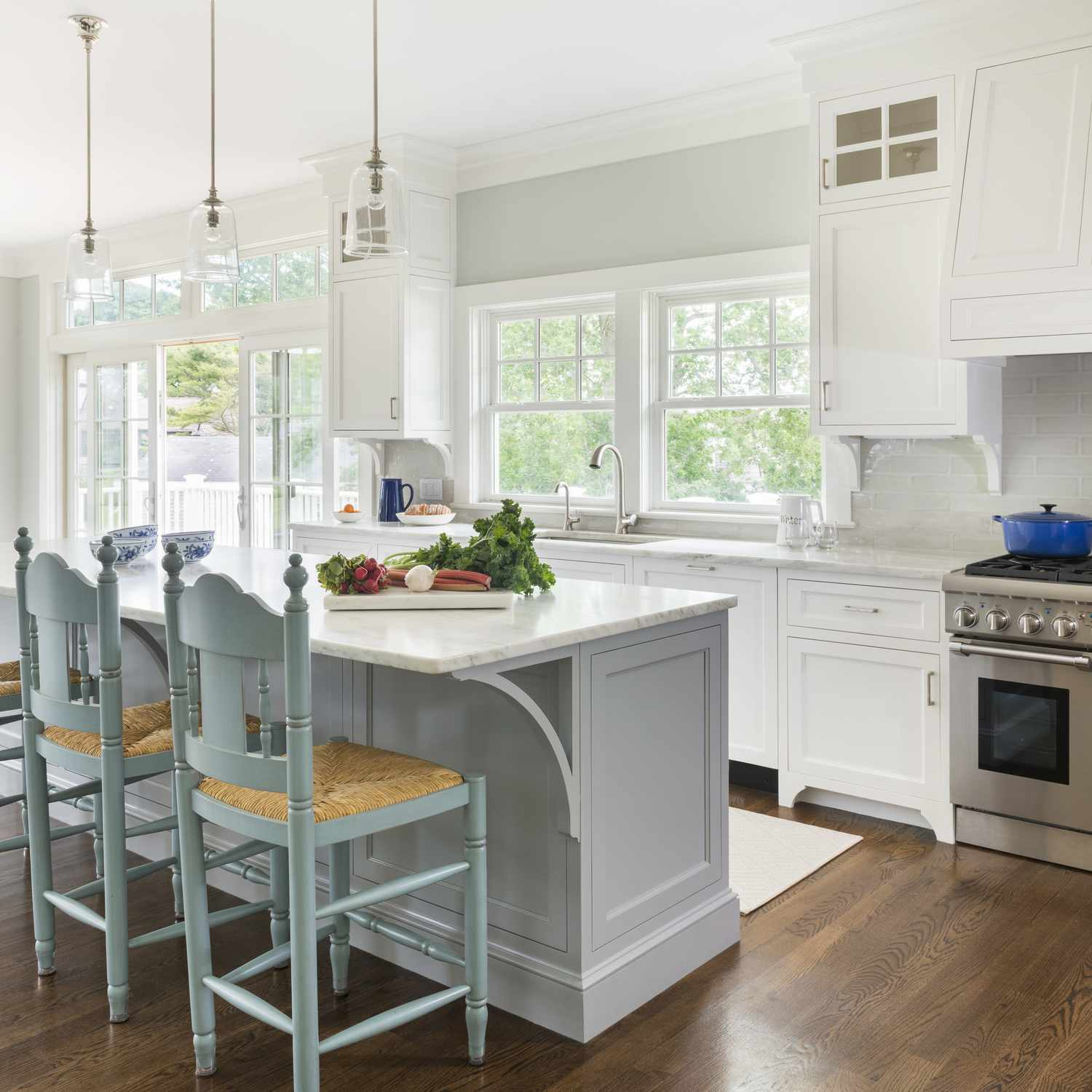 pale kitchen with light blue chairs