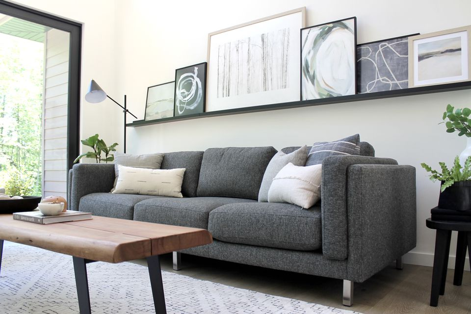 charcoal grey sofa with throw pillows
