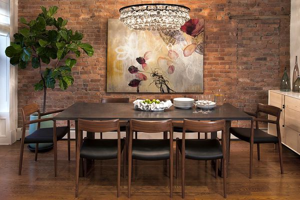 a dining room with exposed brick walls, wooden pieces, and other natural elements