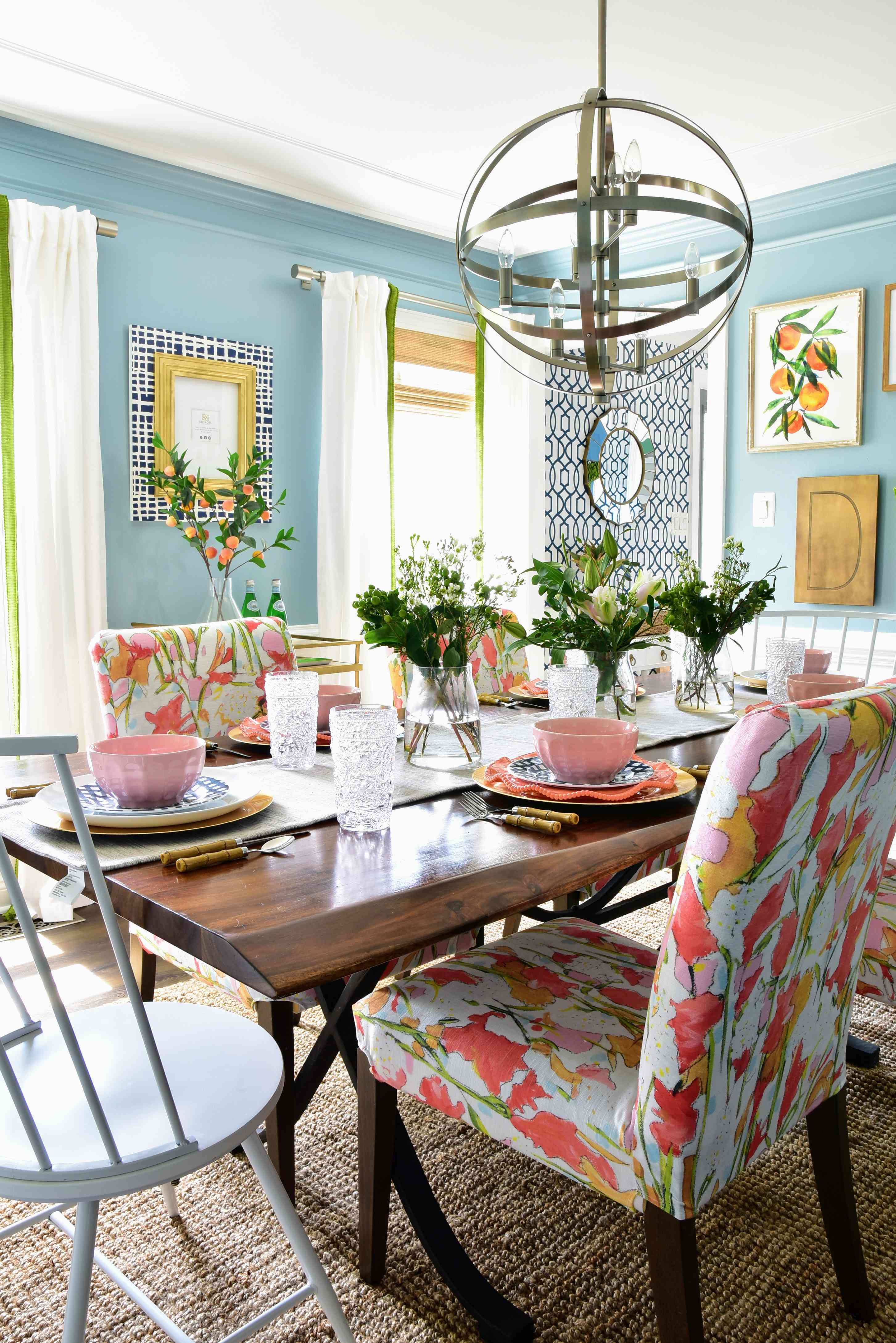colorful dining room with florals and jute rug