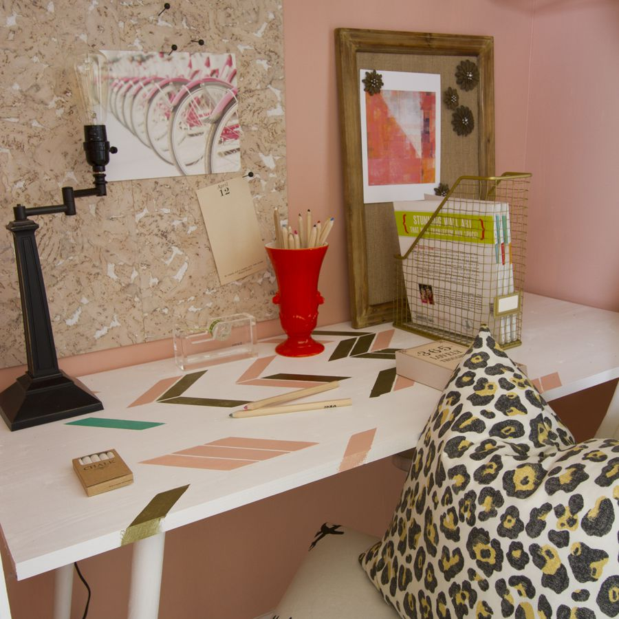 Pink walls with pink accents on white desk
