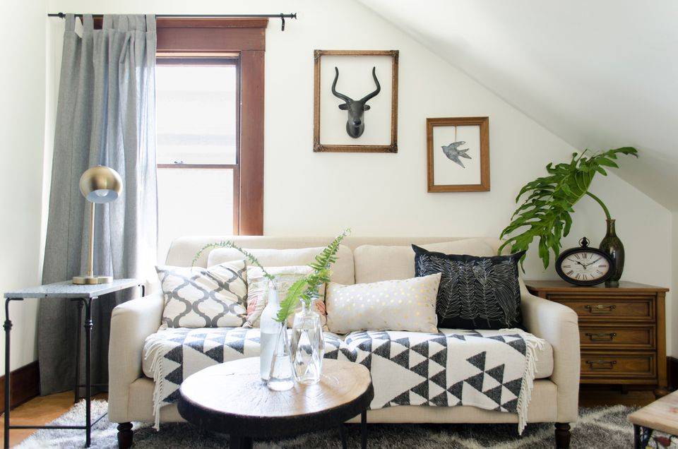 Living room decorated with white couch and white and black decor items