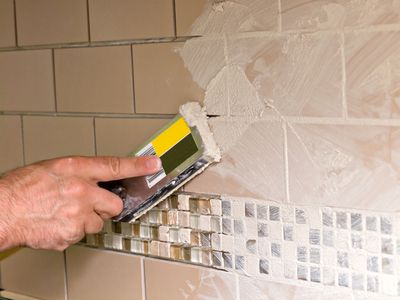 Man applying grout using a grout float.