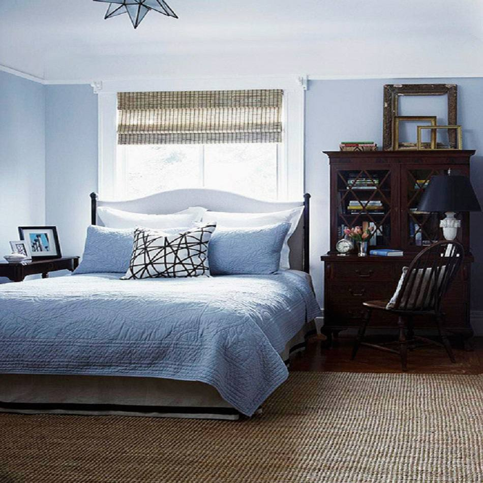 Blue bedroom with antique hutch