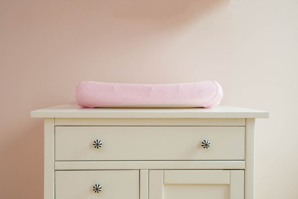 a dresser being used as a changing table