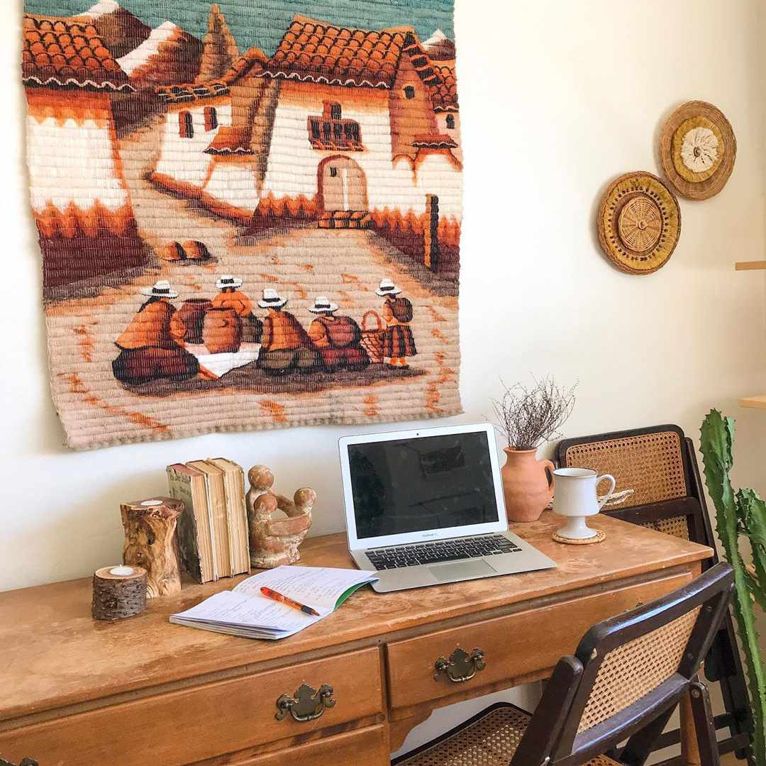 Desk with southwestern print above it