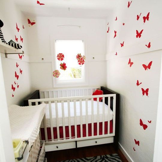 Modern black and white closet nursery with bold red accents