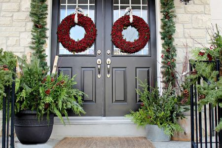 classy green and red holiday porch - Decorating Front Porch Urns For Christmas