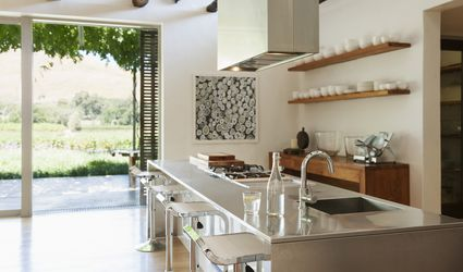 A modern kitchen overlooking patio and vineyard