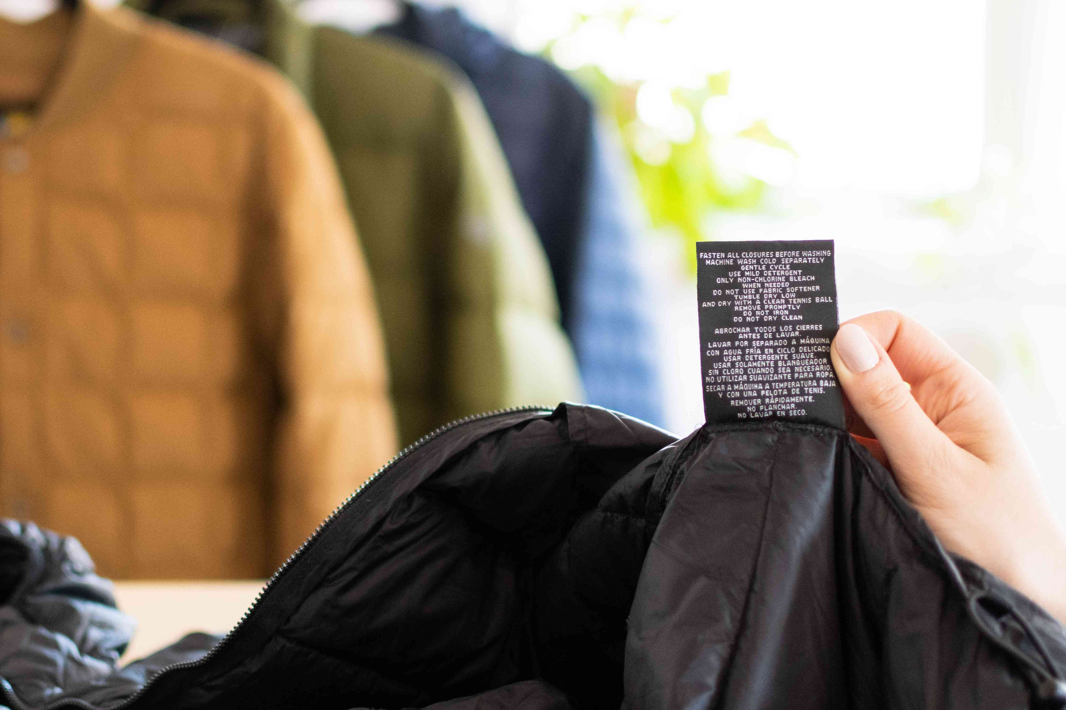 Care labels being read for black down coat