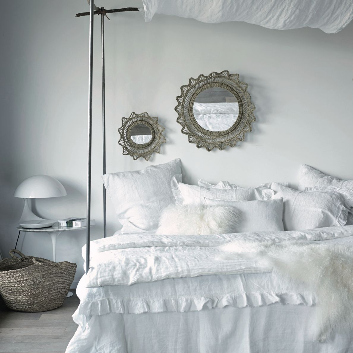 White bedroom with ruffled bedding