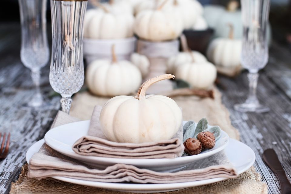 White pumpkin and other decor on table