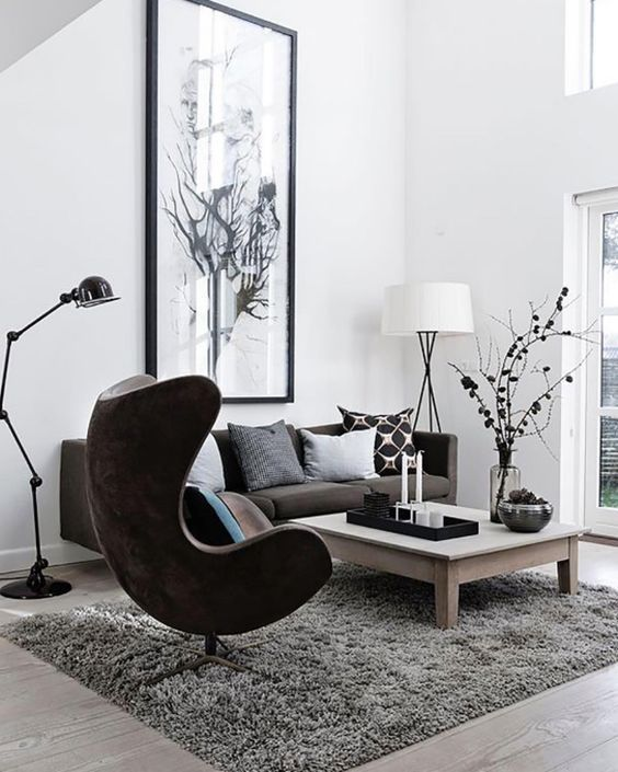 Black and white living room with large art piece