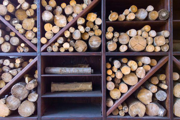 A wooden firewood rack holding firewood