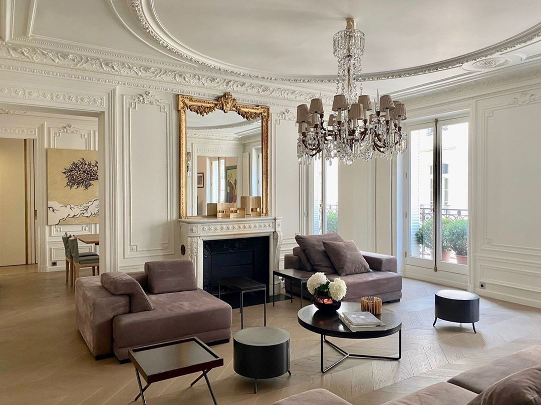 Large living room with gold accents