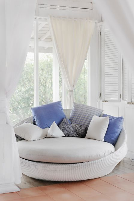 Large papasan chair with nautical colored pillows