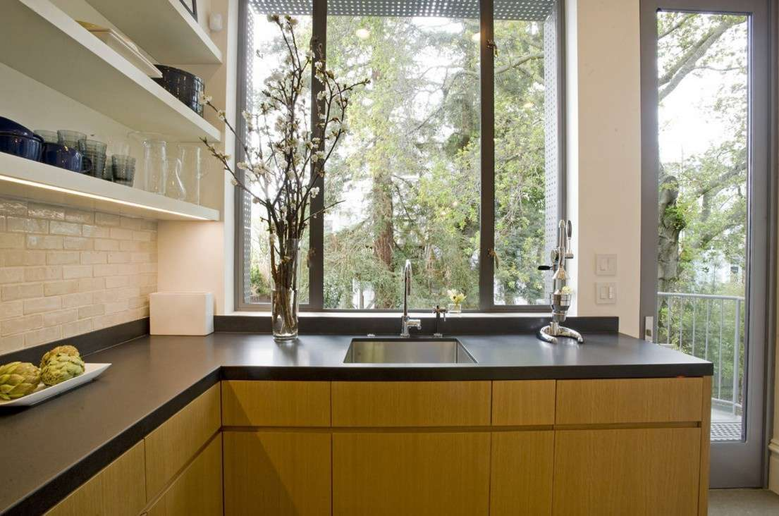black laminate countertops with wood cabinets