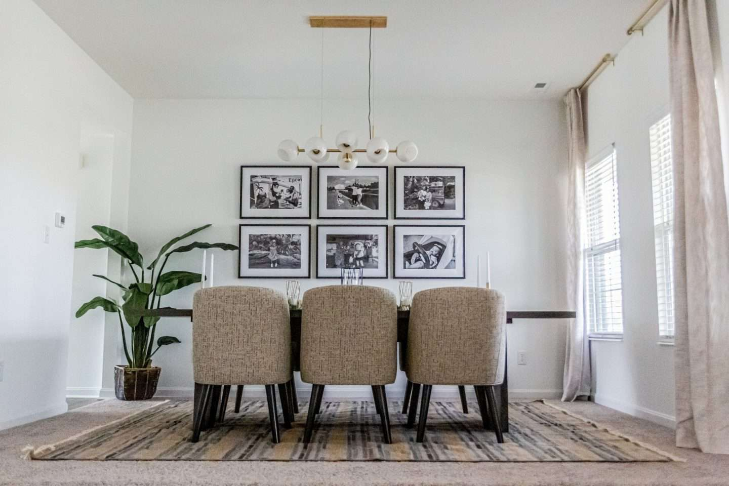 family photos in black and white in dining room