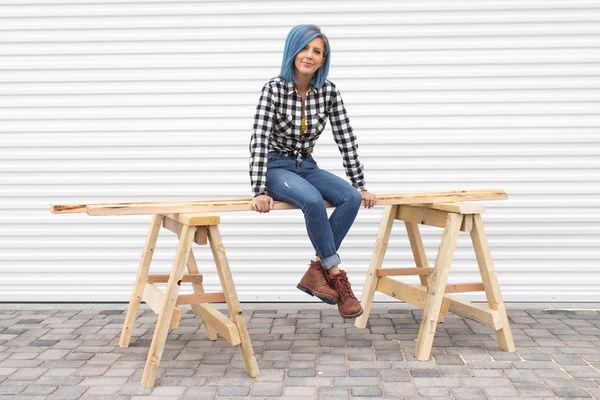 Elisha Albretsen sitting on a wood planks