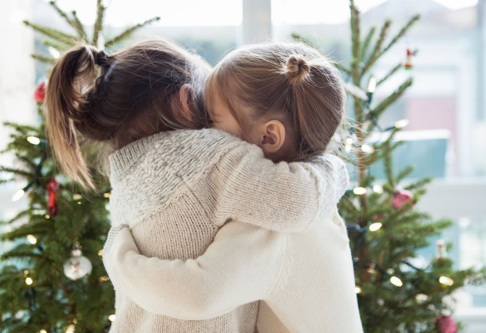 Two little girls hugging during Christmas