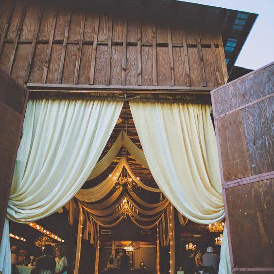 Barn wedding with curtains