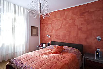 Modern Bedroom With An Orange Wallpaper Accent Wall