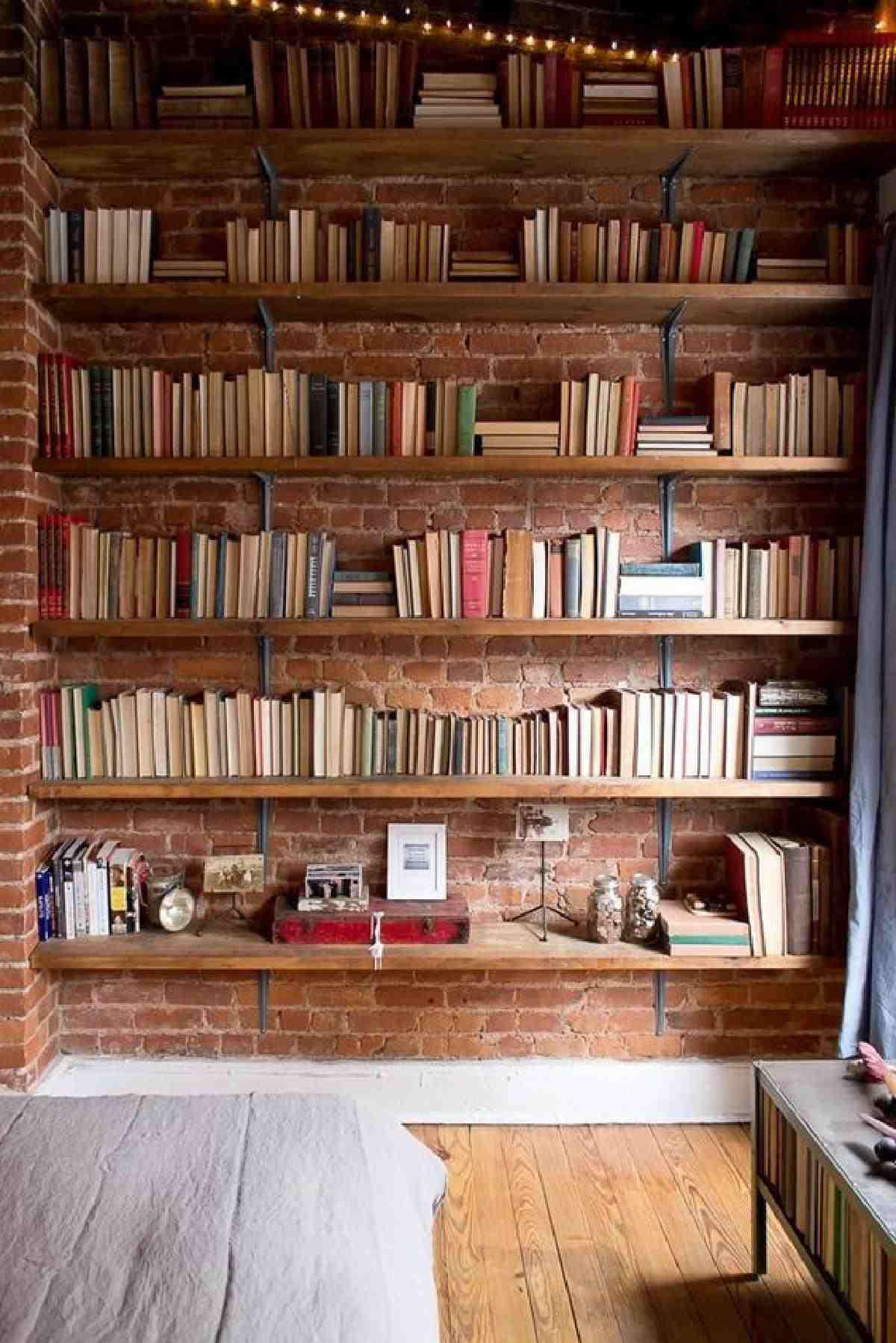brick wall with exposed bookshelf