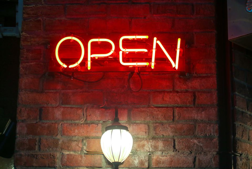 neon signs exterior sign open brick wall night fill digipub getty