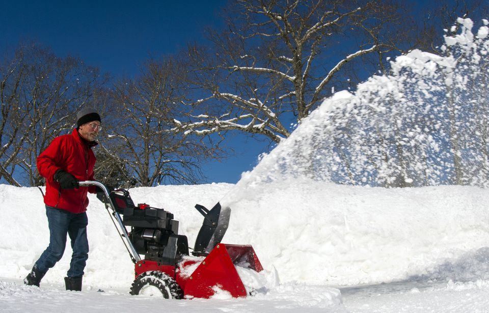Man using gas snowblower in Damariscotta, Maine.