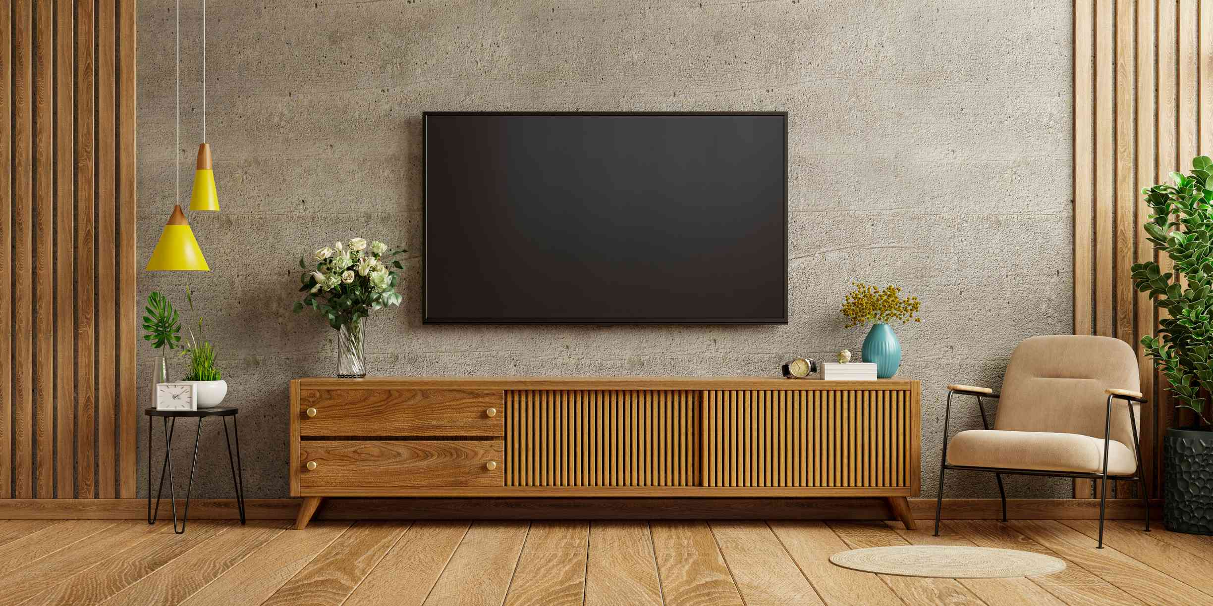 A large tv with media console in a living room