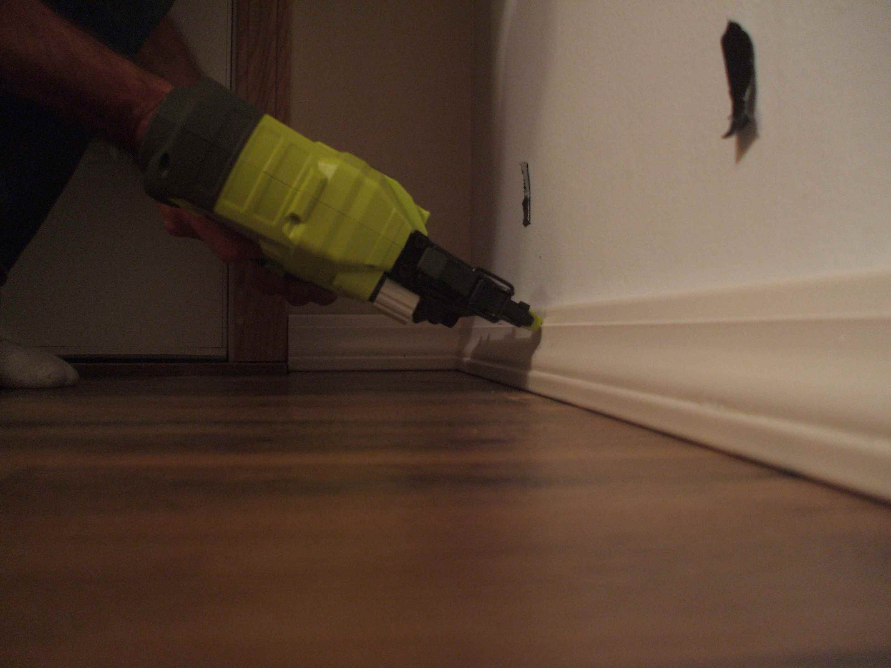 Nail Baseboards in Place
