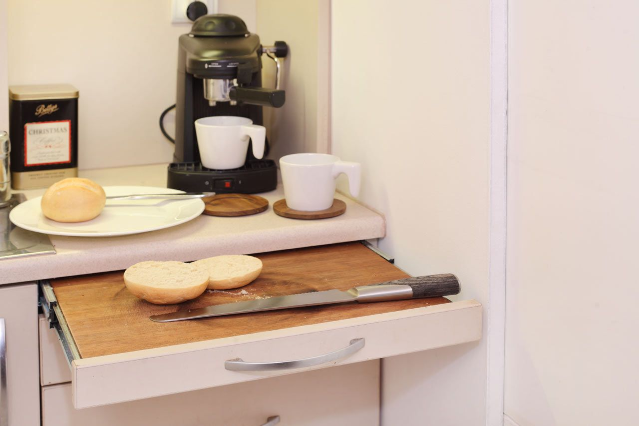 Slide out compartment cutting board