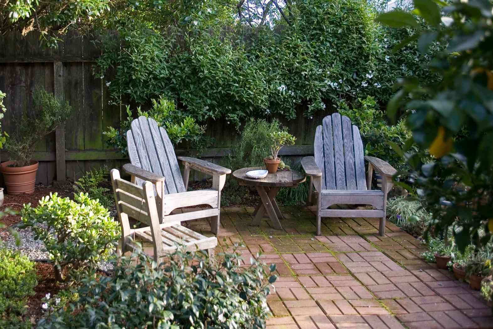 Weathered teak furniture on a patio